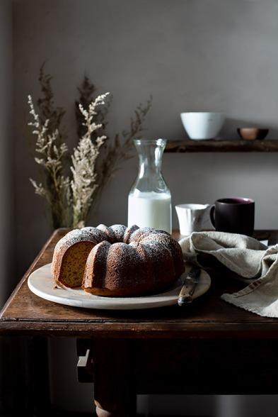 bundt-cake-rustic-farmhouse-kitchen-missing-slice-stock-food-photo